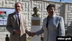 Paris Mayor Bertrand Delanoe (L) and Ramallah Mayor Janet Mikhail (R) attend the inauguration of the bust of Stephanie Von Parys, first wife of French sculptor Bourdelle, offered by the city of Paris, on November 29, 2011 at the Garden of Nations in the W