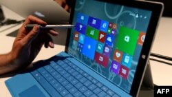 The new Microsoft Surface Pro 3 tablet with detachable keyboard and pen for writing on the screen after it was unveiled May 19, 2014 in New York. Microsoft unveiled the Surface Pro 3 tablet at an event in New York on Tuesday, as it attempts to fuel intere